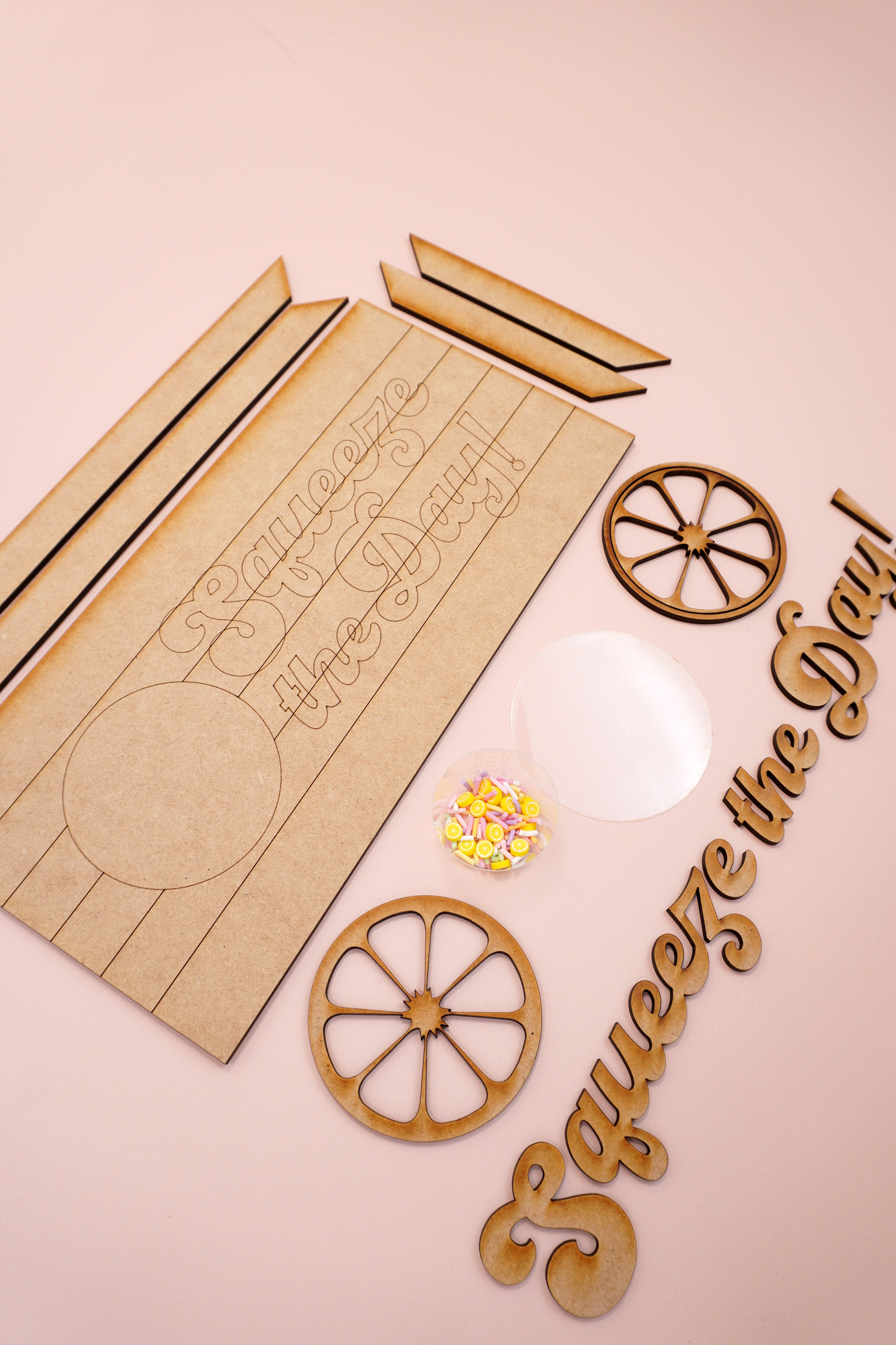 Squeeze the Day laser cut sign pieces on peach background