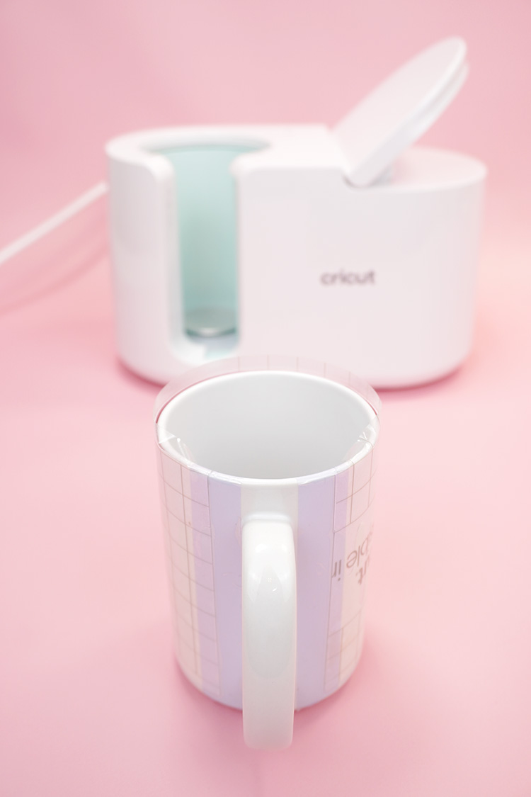 Wrapping a white sublimation mug with Infusible Ink and heat tape