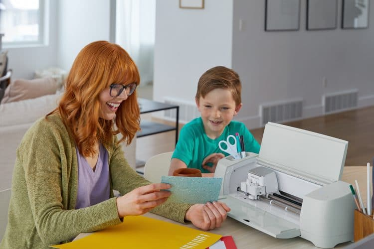 White woman and boy making cards with Cricut Explore 3