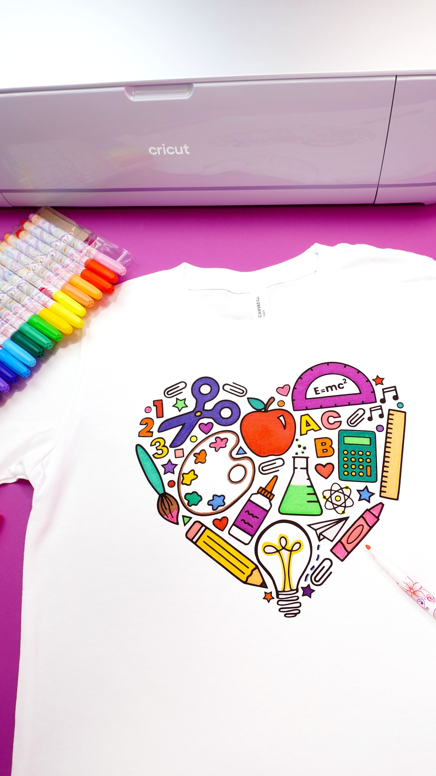 Back to school coloring shirt on a purple background with fabric markers and Cricut Maker 3