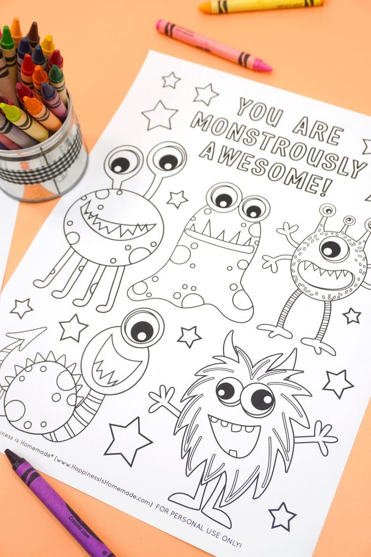 """""""You Are Monstrously Awesome"""" monster coloring page on orange background with crayons"""