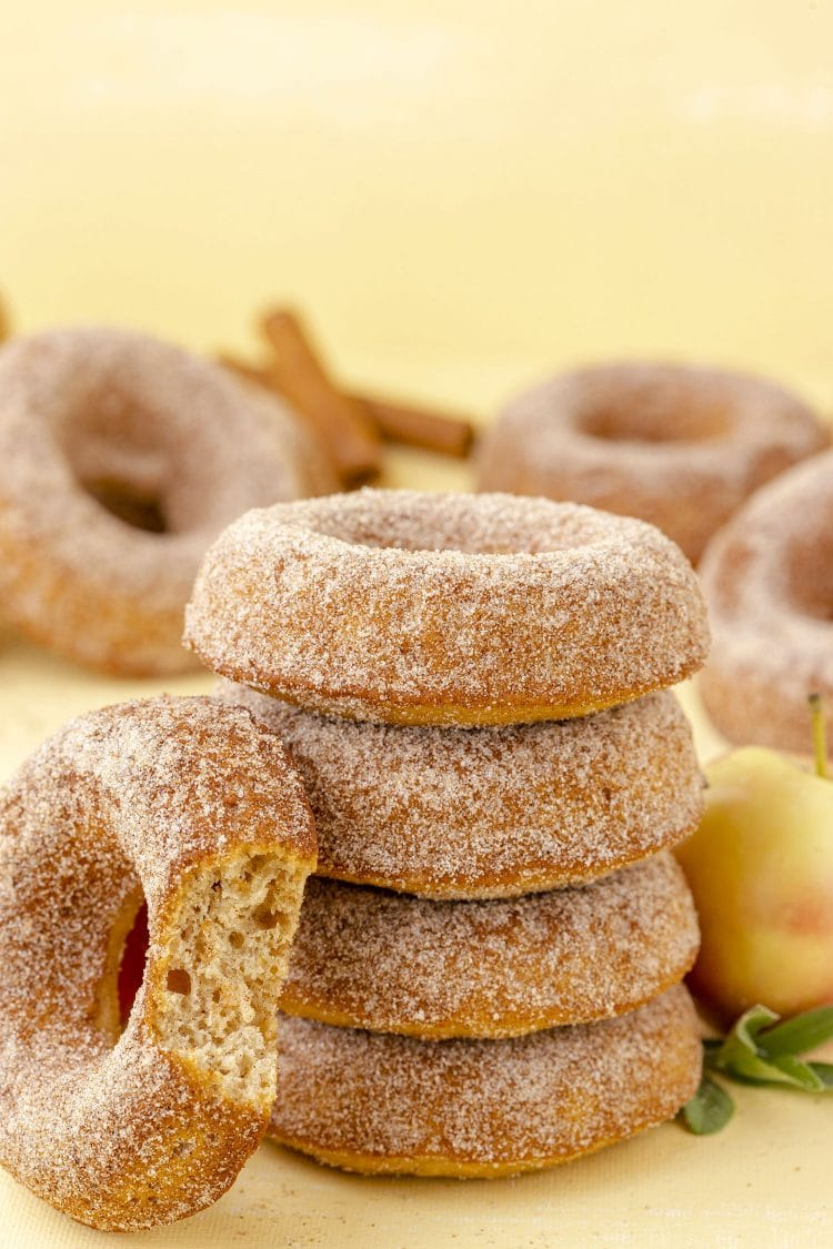 stack of apple cinnamon apple cider donuts on yellow background