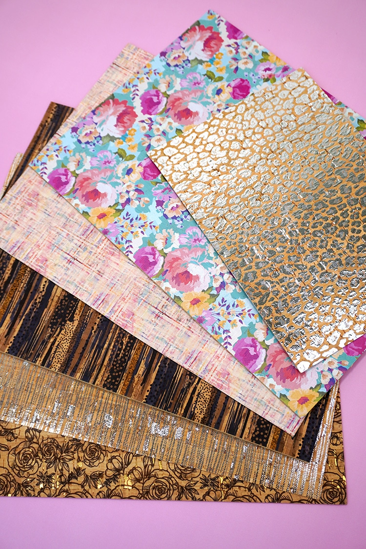 Sheets of patterned cork on purple background