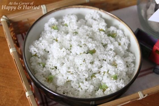 White Flowers in Black Bowl