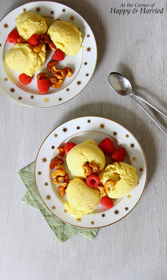 Mango Ice Cream Bowl With Cashews and Raspberries