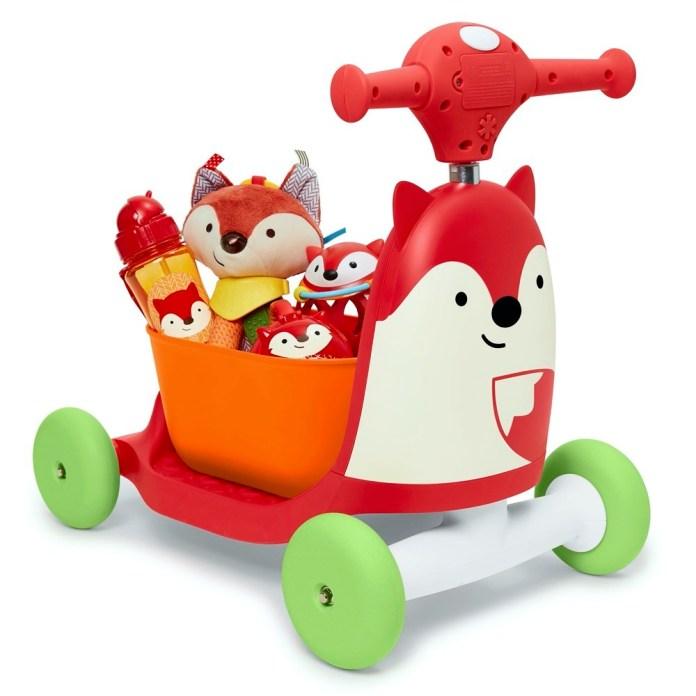 """Das """"Zoo 3-in-1""""-Gefährt von Skip Hop hat eine orange Sitzeinheit, die auch als Spielzeugtruhe umfunktioniert oder ganz abgenommen werden kann."""