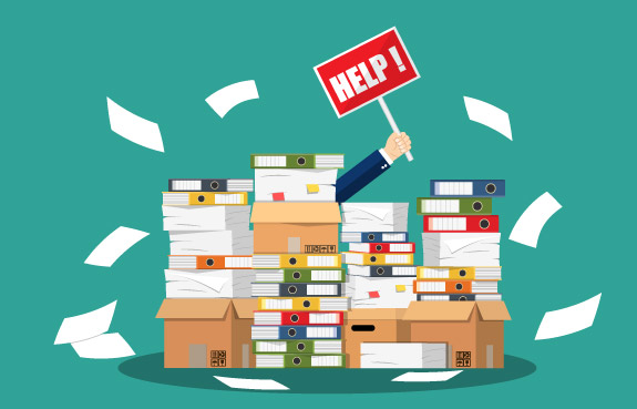 A hand with a Help sign reaches up out of a pile of papers, binders and boxes. Small business bookkeeping to the rescue :D