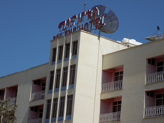 This photo shows the modern, white facade of the Milano Hotel, Mekele,