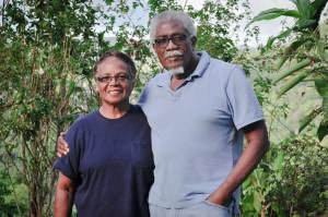 This photo shows Gloria and Theo Ferguson standing in their garden at Yerette
