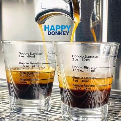 Image displaying marked shot glasses.