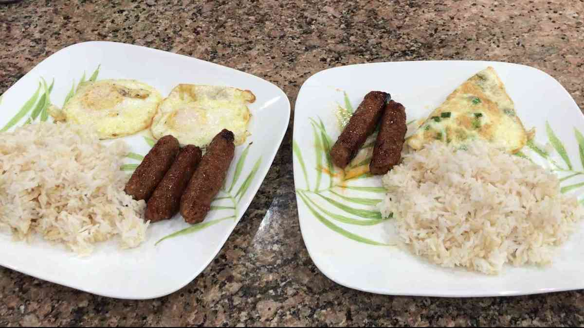 Two plates of rice with eggs Filipino Longanisa and eggs cooked.