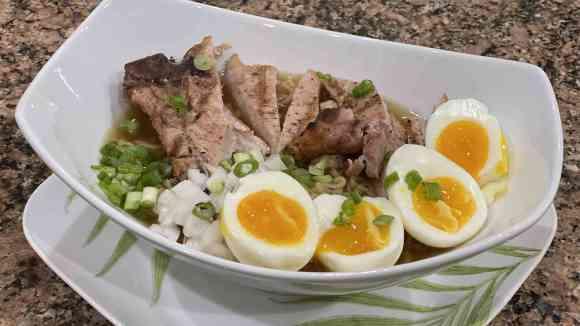 Instant Ramen Noodles with Hard Boiled egg and pork chops.