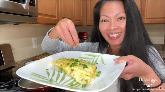 woman serving denver omelet