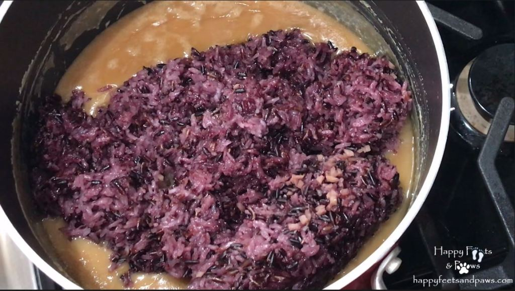 black rice being added to coconut milk for biko recipe
