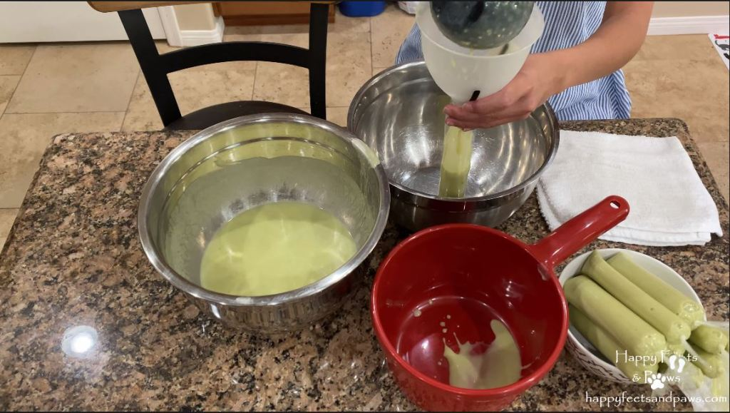 pouring avocado ice candy mix into plastic wrapper before freezing