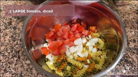 pasta salad being mixed