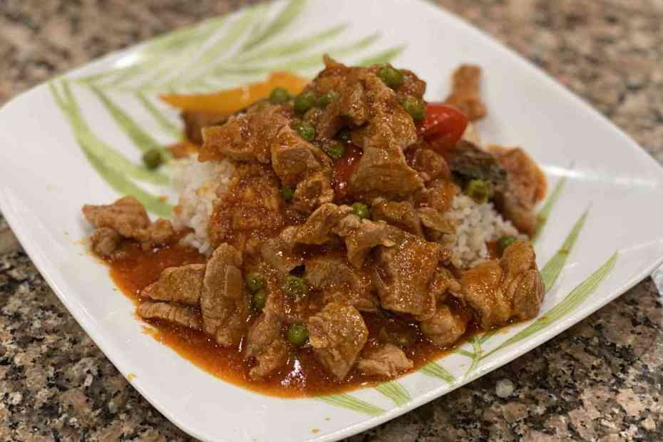 Pork Guisantes on a plate with white rice