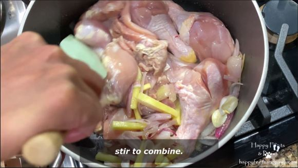 chicken being cooked in pot for tinolang manok recipe