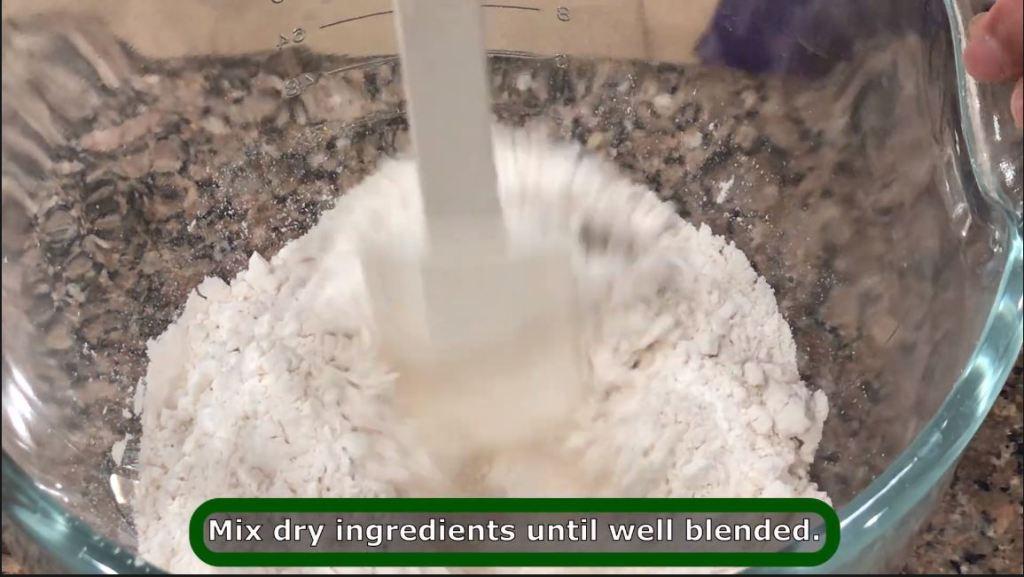 Mixing flour for pelmeni recipe