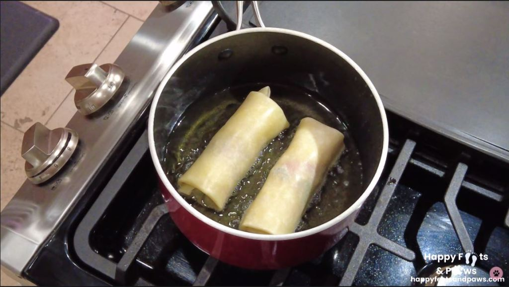 south west egg rolls being cooked in oil on a stove