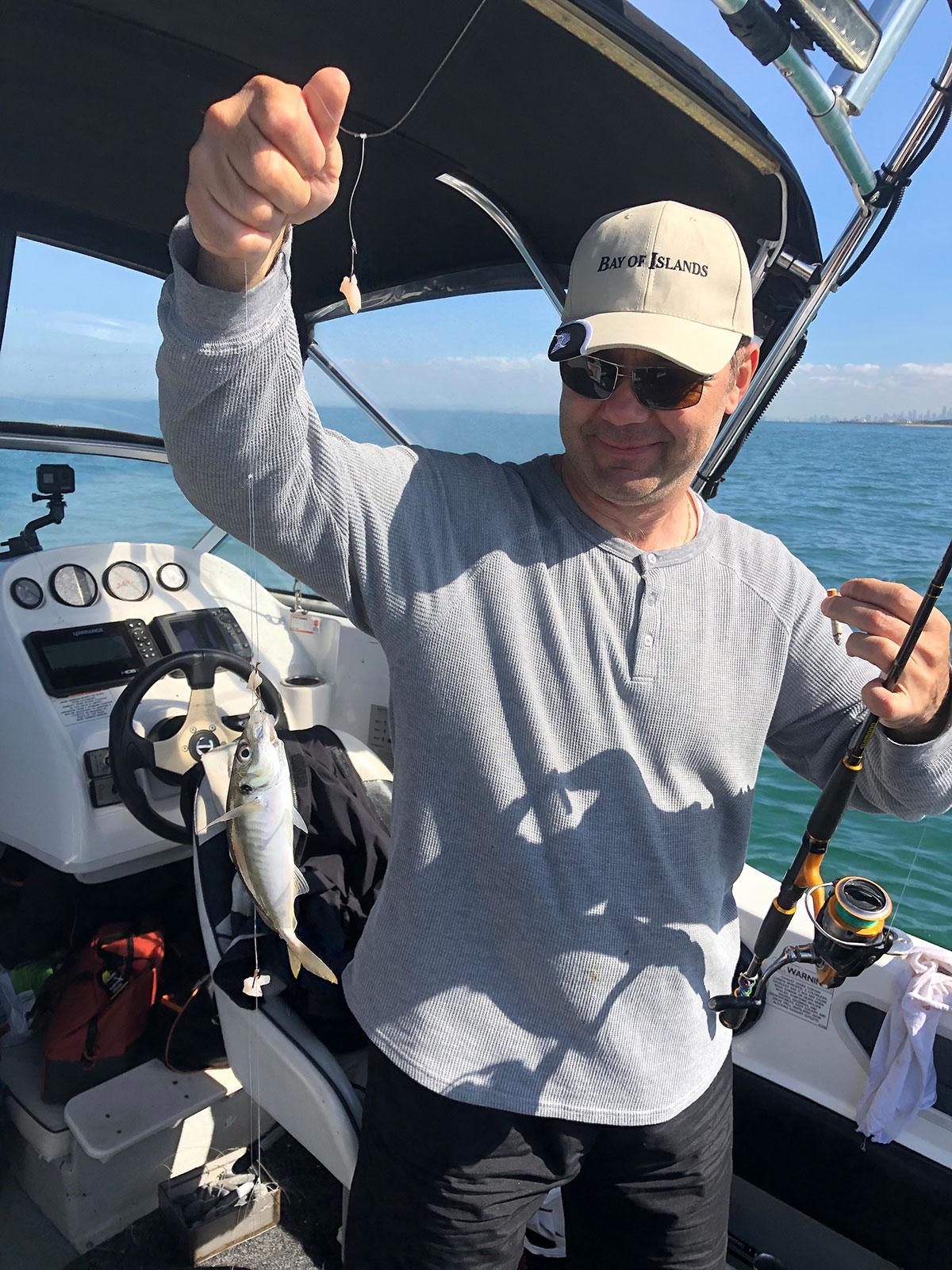 happy fisherman fishing black rock