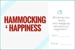 Gift ideas for dog owners can include this free printable gift tag that says HAMMOCKING and HAPPINESS in red with caption wishing you many tail-wagging adventures together