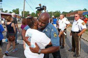 Captain Ferguson hugging a protestor