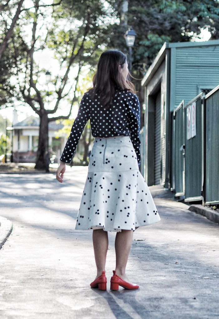 polka dot blouse and skirt and red shoes