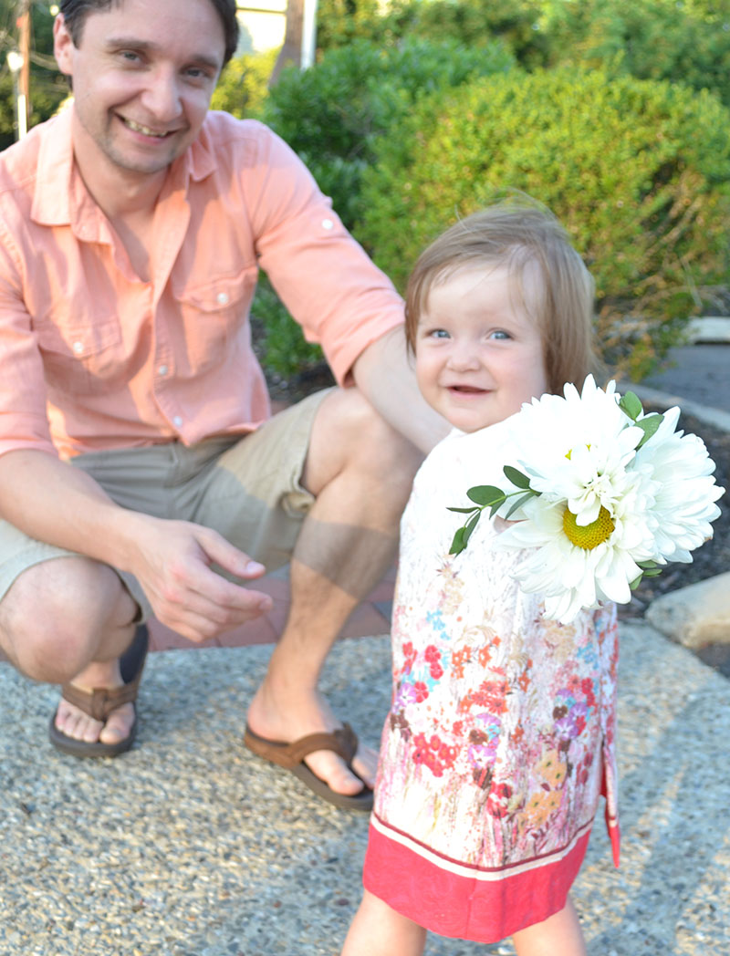 a further gives a bouquet to her daughter