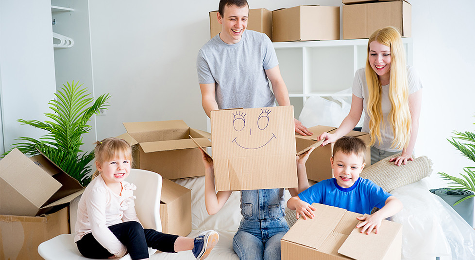 family holding boxes in home