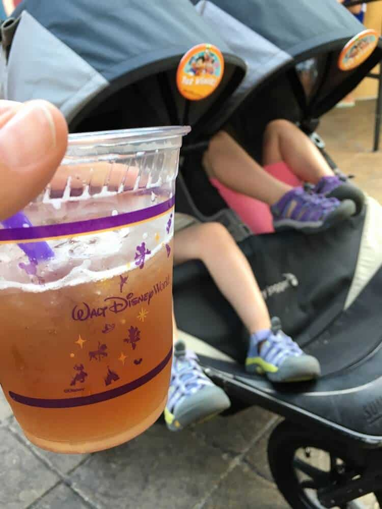 Drinking an alcoholic beverage at Epcot. | Last Minute Disney World Vacation | Disney World Family Vacation | Disney World Planning | Disney World Tips and Tricks