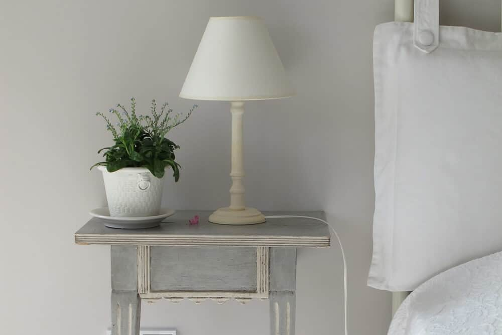 Clear off your nightstand to create a minimalist bedroom!