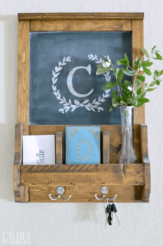 Wooden, farmhouse style family command center with hooks for keys and slots for mail.