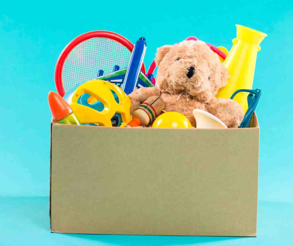 Toys in a donation box.
