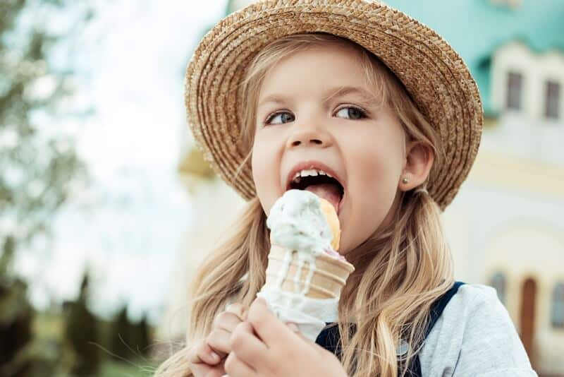 Little girl eating an ice cream cone.
