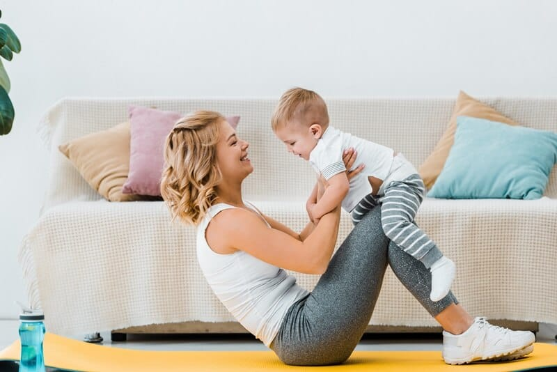 Do sit-ups as a workout for moms. You can involve your kids.