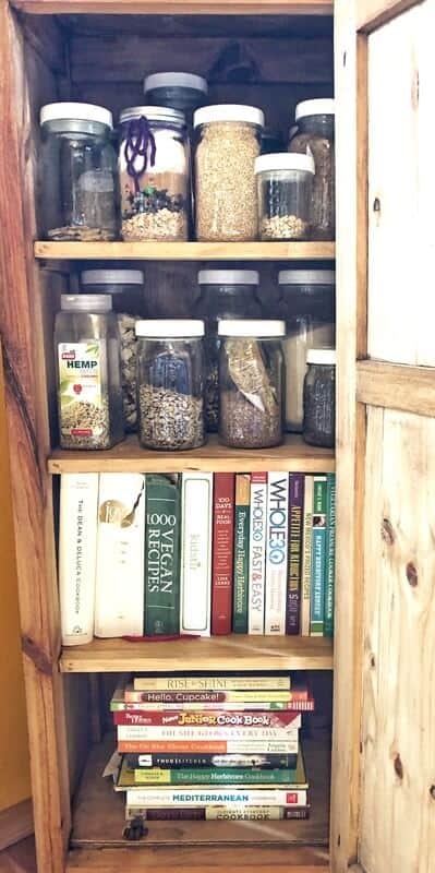 minimalist pantry with mason jar storage and cookbook storage
