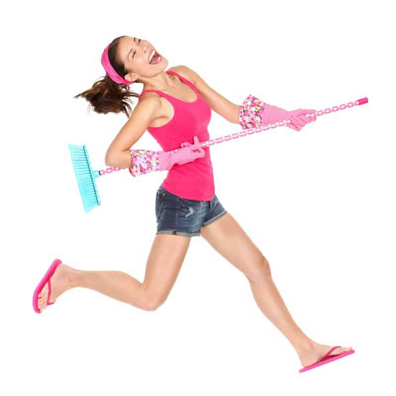 Woman happy to be cleaning with her room and new cleaning schedule!