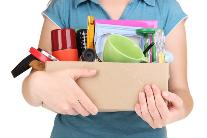 box of items to donate or sell or give away after decluttering