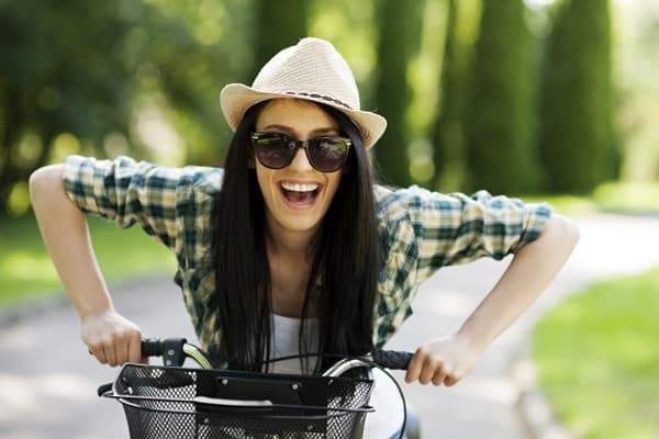 Healthy young woman on a bicycle
