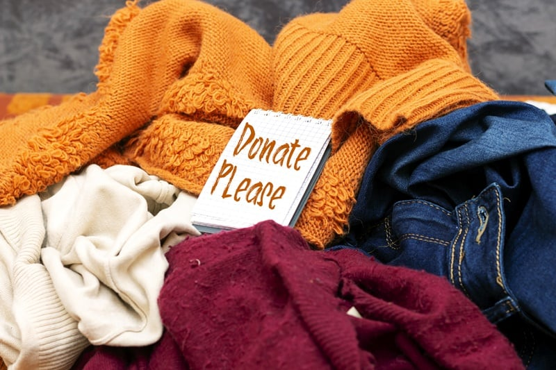 Donate pile of clothes for a year long no shopping challenge