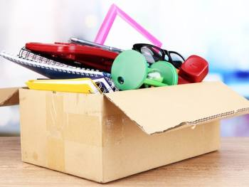 easily decluttered items in a box ready to give away
