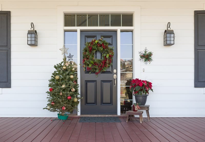 Christmas decorations at front door of house for a clutter-free home.