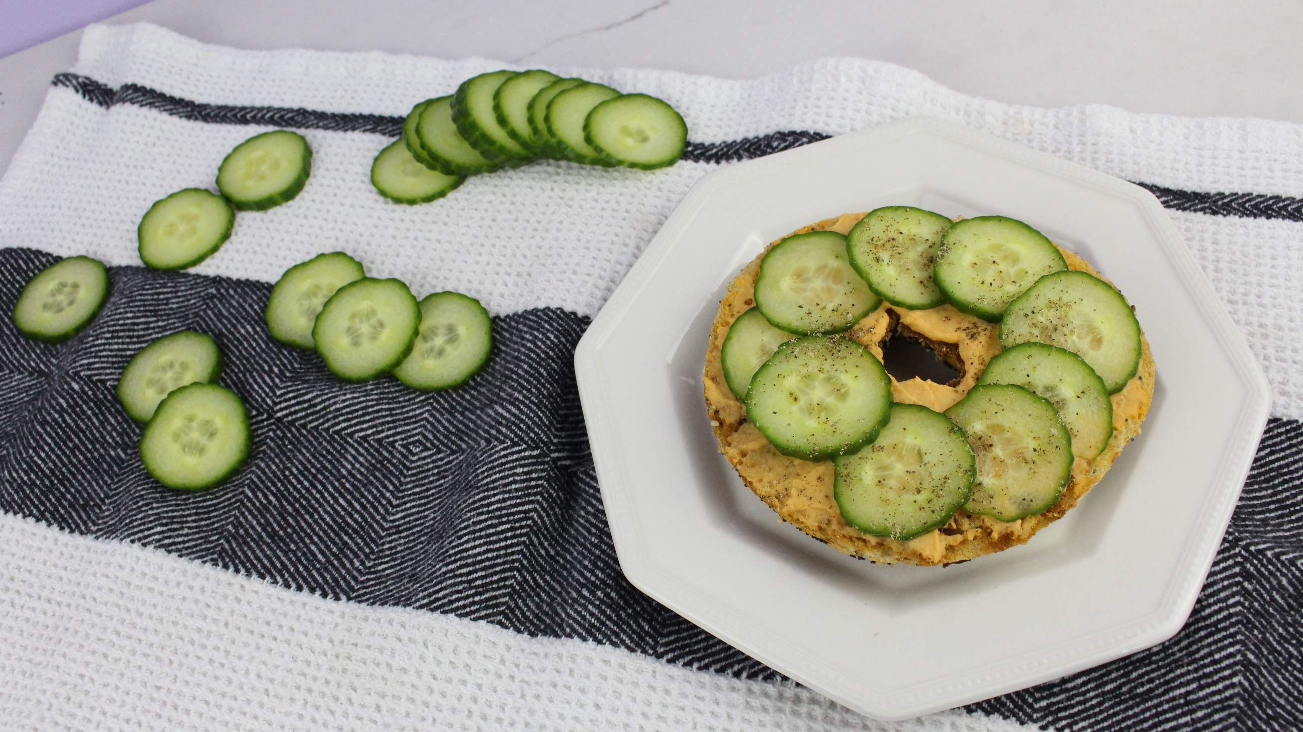 Cucumber and Hummus - 15 Ways to Top Your Breakfast Bagel - Happy Stylish Fit