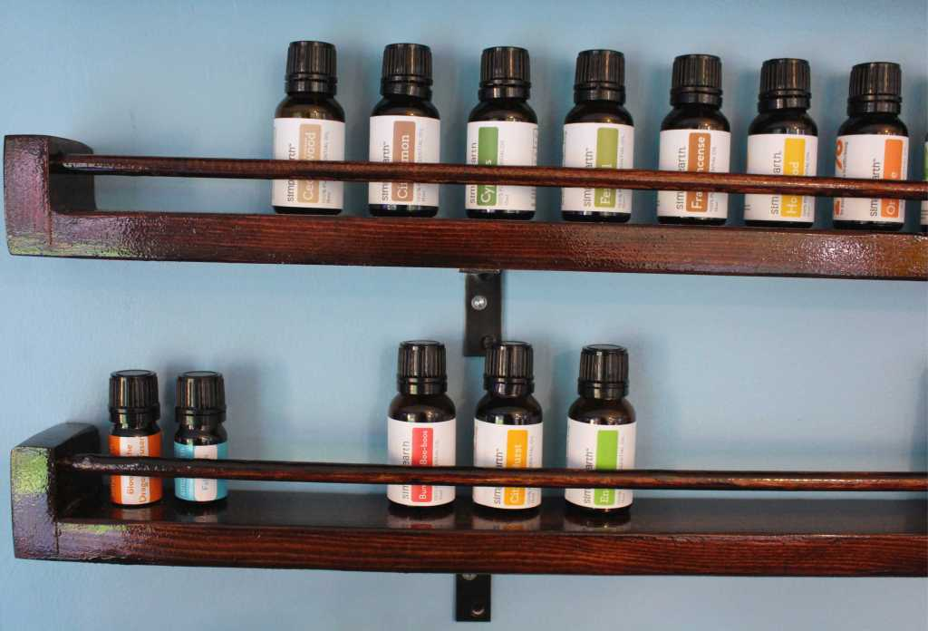DIY Shelves for your essential oils. #EssentialOils #DIY #HomeDecor #SimplyEarth