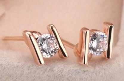 2e33647059a60a Orecchini punto luce placcati oro rosa 18 k e cristalli Swarovski Originali