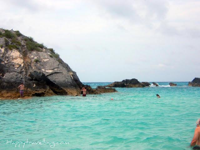 Bermuda ocean with giant rocks and people snorkeling