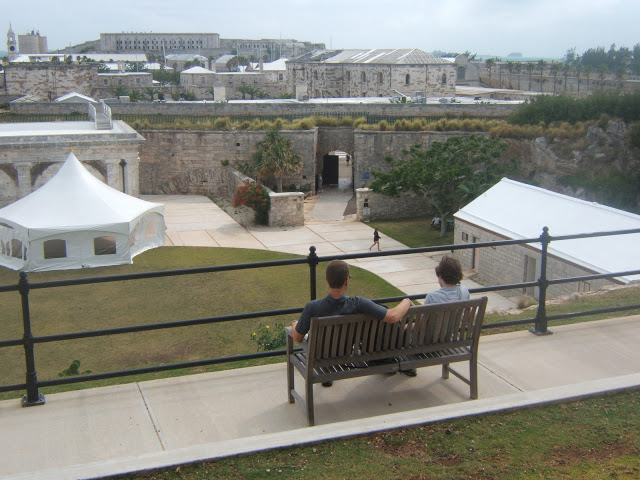 two people looking over the royal naval dockyards in Bermuda