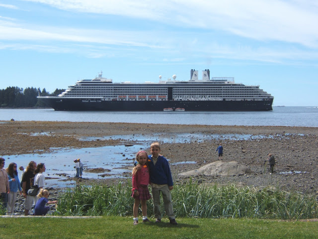 The kids in Alaska with the Oosterdam ship behind