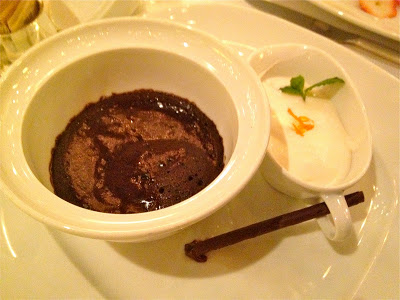 Chocolate souffle with flavored cream